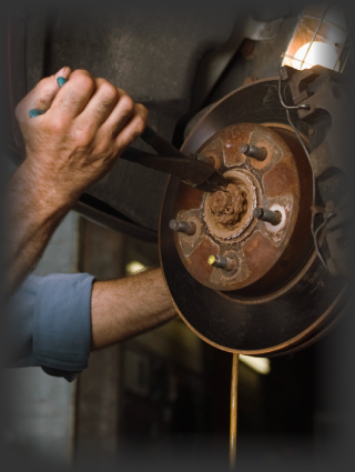 Hands working on brakes | Brake repair in Edmonton